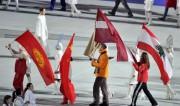 Foto: Soču spēles noslēgušās, Latvijas karogs Dreiškena rokās