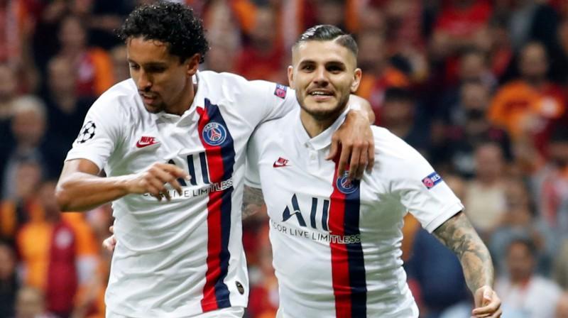 """Parīzes """"Saint Germain"""" futbolisti Markinjoss un Mauro Ikardi. Foto: Umit Bektas/Reuters/Scanpix"""