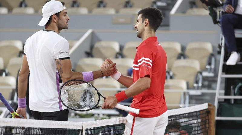 Mateo Berretīni un Novaks Džokovičs. Foto: AFP/Scanpix